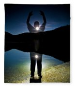 A Man Balances On A Log At Night Fleece Blanket
