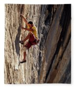 A Man Climbing A Big Wall In El Potrero Fleece Blanket