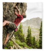 A Man Clinging To Rock Face In The Fleece Blanket