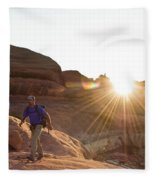 A Man Hiking In The Needles District Fleece Blanket
