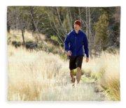 A Man In A Blue Jacket Walks Fleece Blanket