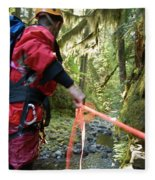 A Man Lowers A Rope For Canyoning Fleece Blanket