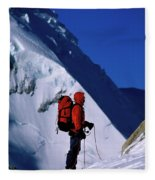 A Man Mountaineering In The Alps Fleece Blanket