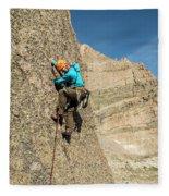 A Man Rock Climbing In Rocky Mountain Fleece Blanket
