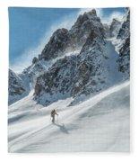 A Man Ski Touring In The Mountains Fleece Blanket