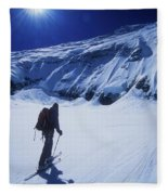 A Man Ski Touring Under Blue Skies Fleece Blanket