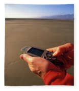 A Man Using A Gps Device At Sunset Fleece Blanket