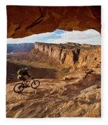 A Mountain Biker Rides By On Slickrock Fleece Blanket