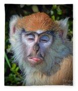 A Patas Baby Monkey Behaving Badly Fleece Blanket