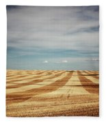 A Pattern Of Stripes Across A Farmers Fleece Blanket