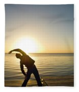 A Person Practices Yoga At The Waters Fleece Blanket