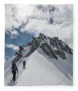 A Rope Team Climbs A Ridge Fleece Blanket