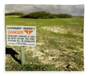 A Sign Warns Of Dangerous Unexploded Fleece Blanket