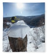 A Snowboarder Jumps Off A Cliff Fleece Blanket