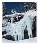 A Snowboarder Jumps Off An Ice Fleece Blanket