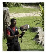 A Trainer And A Large Bird Of Prey At A Show Inside The Jurong Bird Park Fleece Blanket