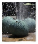 A Water Fountain With Dinosaur Eggs In The Universal Studios Singapore Fleece Blanket