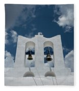 A Whitewashed Bell Tower And Dramatic Fleece Blanket