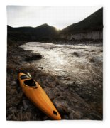 A Whitewater Kayak Rests On The Shore Fleece Blanket