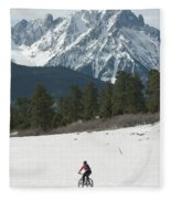 A Woman Bike Riding On The  Snow Fleece Blanket