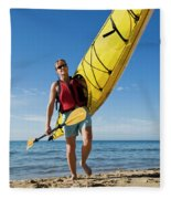 A Woman Carrying Her Sea Kayak Fleece Blanket