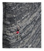 A Woman Climbs Above Her Protection Fleece Blanket