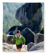 A Woman Hiking High In The Mountains Fleece Blanket