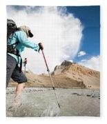 A Woman Is Crossing A River, Spiti Fleece Blanket