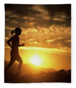 A Woman Jogs Under Sunset Fleece Blanket
