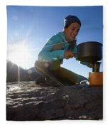 A Woman Making Coffee With Portable Fleece Blanket