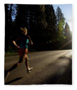 A Woman Running On A Country Road Fleece Blanket