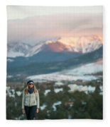 A Woman Stands Against A Snowy Mountain Fleece Blanket