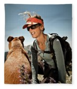 A Woman  Talks To Her Dog While Taking Fleece Blanket
