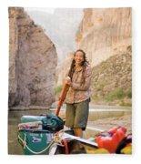 A Woman Unloads Gear From Her Canoe Fleece Blanket