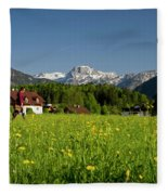 A Woman Walks Through An Alpine Meadow Fleece Blanket