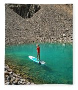 A Young Male Paddleboarding On A Small Fleece Blanket