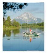 A Young Man Fly Fishes From His Drift Fleece Blanket