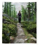 A Young Woman Walks Along An Sub-alpine Fleece Blanket