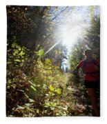 An Adult Woman Trail Running Fleece Blanket