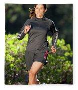 An Athletic Woman Trail Running Fleece Blanket