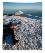 An Exhausted Climber Lies On The Summit Fleece Blanket