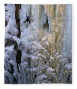 An Ice Climber Ascends A Frozen Fleece Blanket