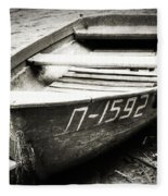 An Old Row Boat In Black And White Fleece Blanket