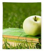 Apple On Pile Of Books On Grass Fleece Blanket