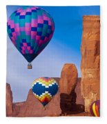Balloon Festival In Monument Valley Fleece Blanket