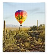 Balloon Ride Over The Desert Fleece Blanket