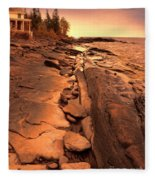 Beach House On Rocky Shore Fleece Blanket