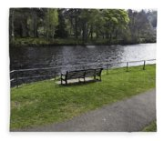 Bench On Shore Of River Ness In Inverness Fleece Blanket
