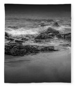 Black And White Photograph Of Waves Crashing On The Shore At Sand Beach Fleece Blanket