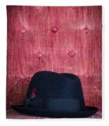 Black Hat On Red Velvet Chair Fleece Blanket
